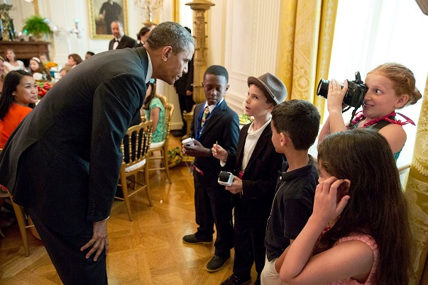 President Barack Obama greets children at the Kids' State Dinner in the East Room of the White House, July 9, 2013.  (Official White House Photo by Pete Souza)